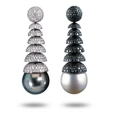South Sea pearl earrings by de GRISOGONO. Features one black pearl and one white pearl set with pave white and black diamonds. The pearls are each 16 millimeters in diameter.