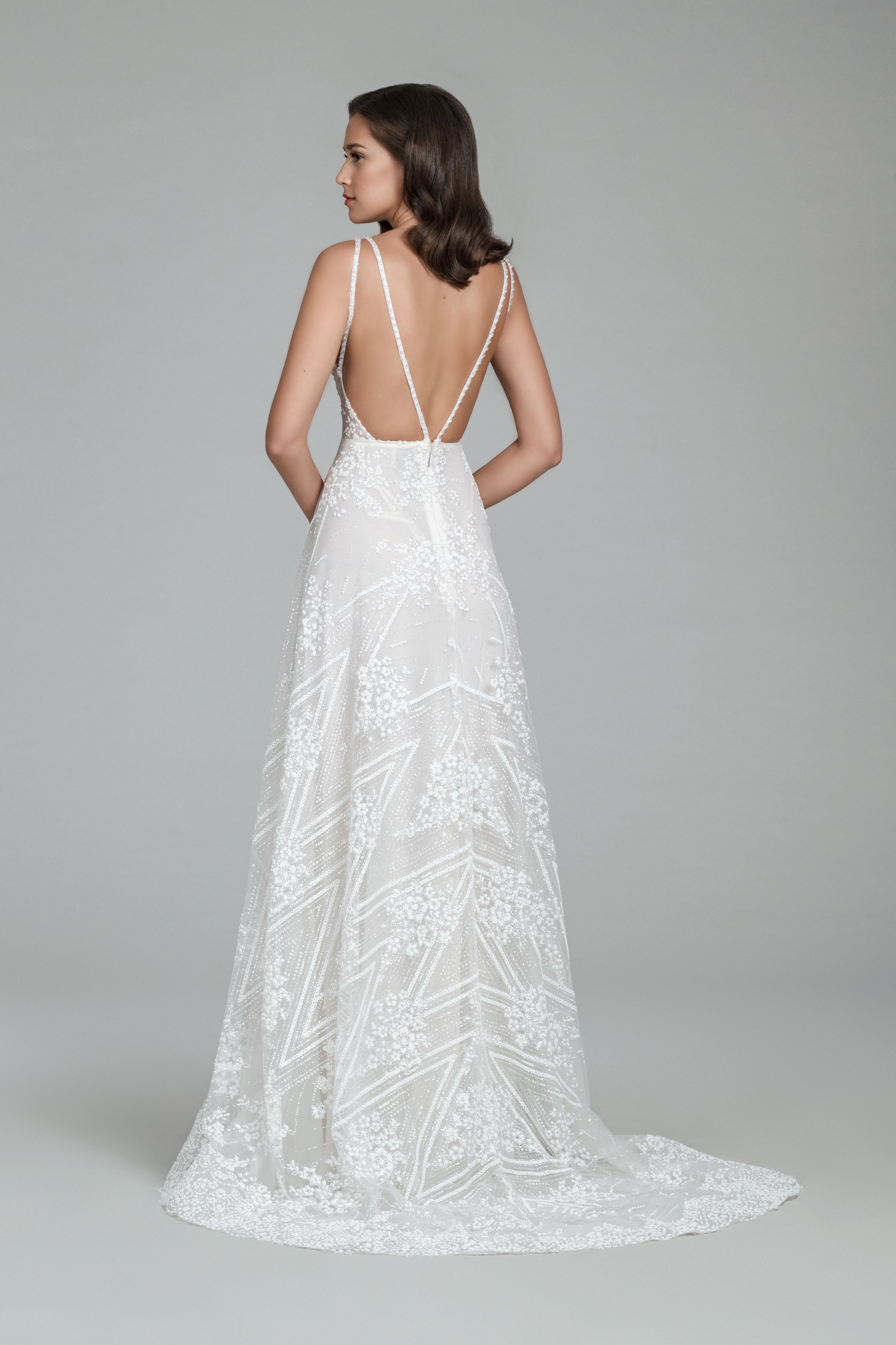 2295f194a6b5 Ivory beaded floral and chevron modified Aline gown, illusion V neckline,  open back with dual crystal straps and chapel train.
