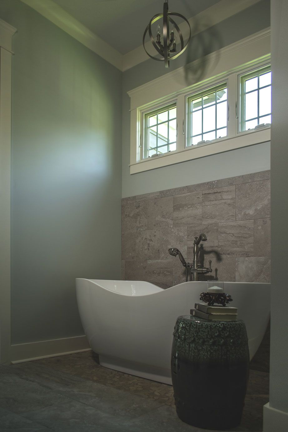 Master bath soaking tub with nickel chandelier. Robin's Nest Interiors - Louisville Interior Design & Home Accessories Boutique located in the heart of Middletown, KY.