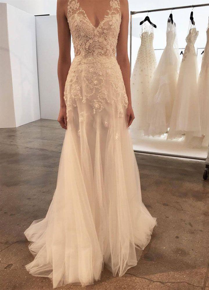 Tulle, bejeweled and v-neckline wedding dress | itakeyou.co.uk #weddingdress #vneck #tulle #weddingdresses #weddinggown