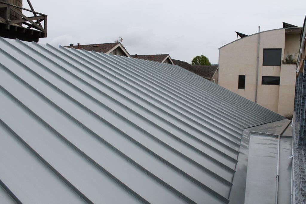 Blue Gray Rheinzinc Standing Seam Roof And Cricket Roofing Standing Seam Solar Panels