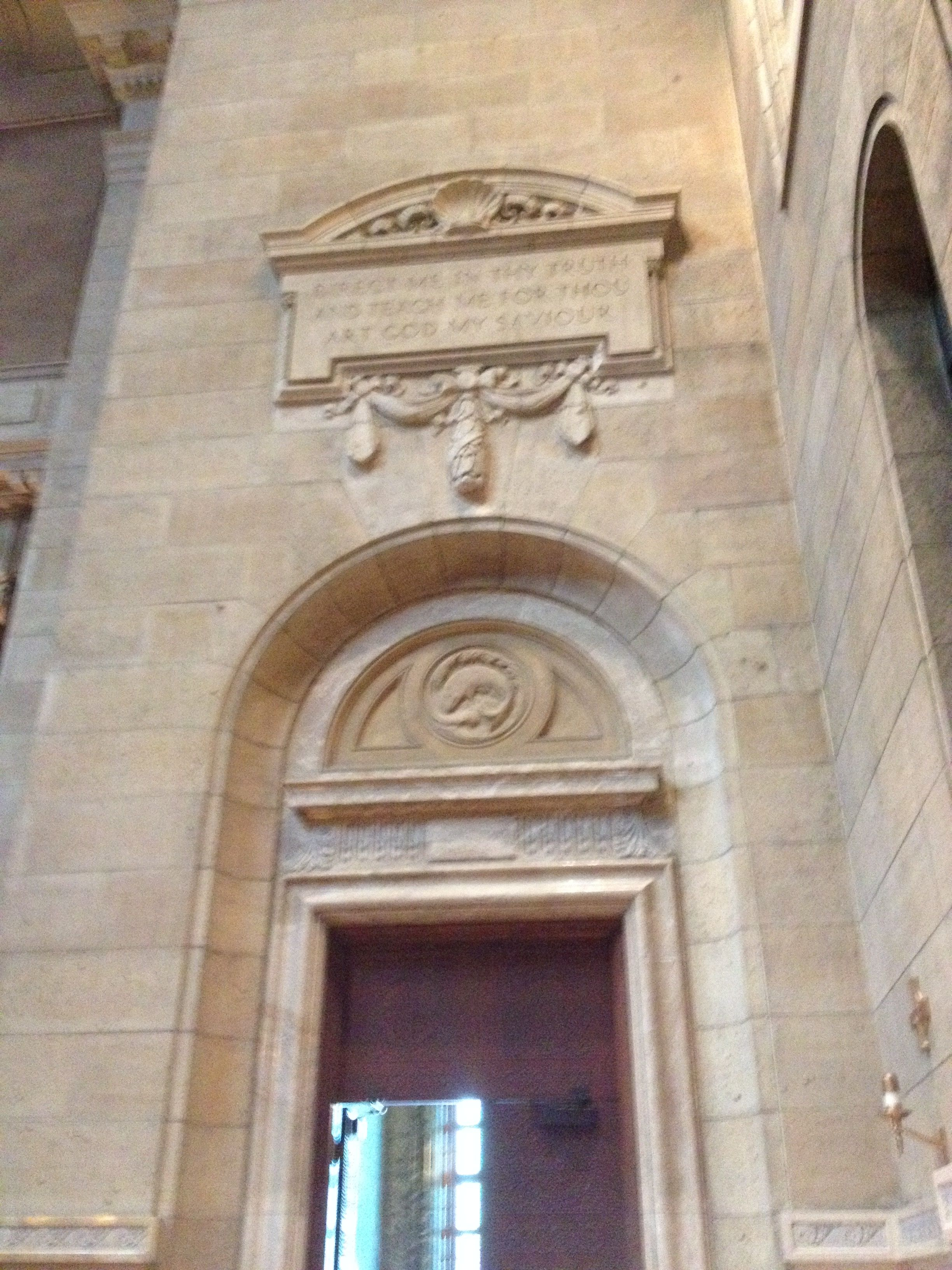 Another side portal with a whale tympanum and apron blessing. | Cathedral of Saint Paul in St. Paul, MN