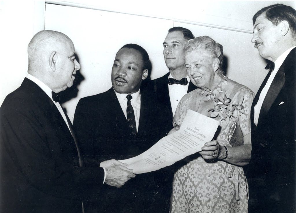 Eleanor Roosevelt presenting Martin Luther King, Jr. with an award from Americans for Democratic