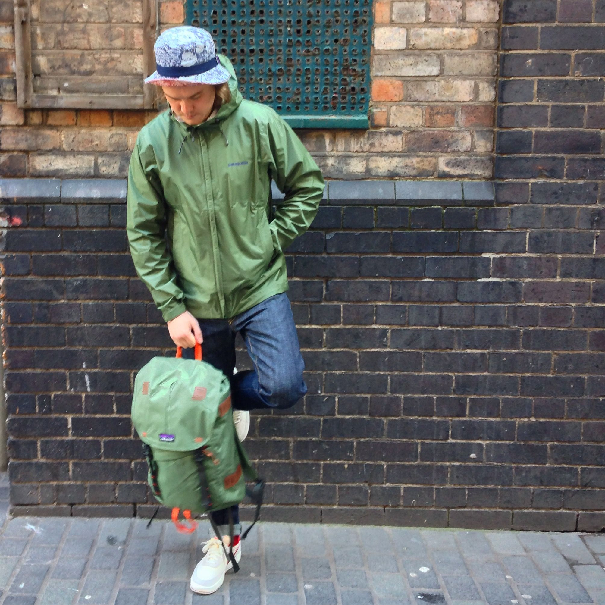 Chris wears; Patagonia Torrentshell Jacket in Camp Green, Wavefearer Bucket  Hat, Arbor 26L