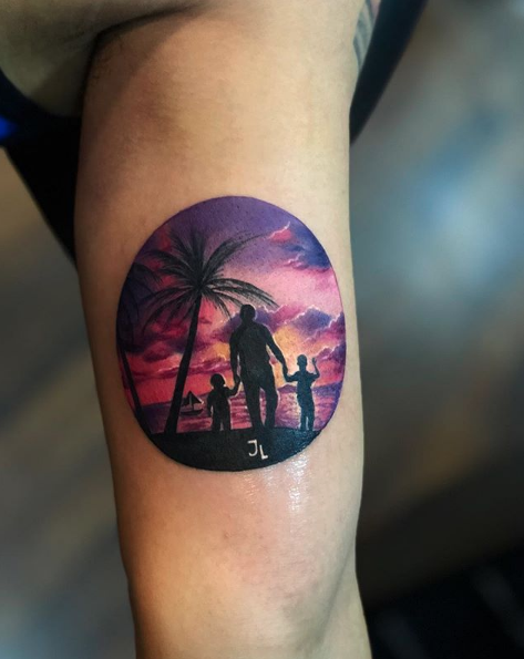 CafeMom.com : Tropical Silhouette Dad Tattoo : 50 Truly Incredible Tattoos to Pay Tribute to Dad -- Perhaps a sentimental snapshot from a favorite family trip, this sunset silhouette of Dad and his kids is like a vacation in tattoo form.
