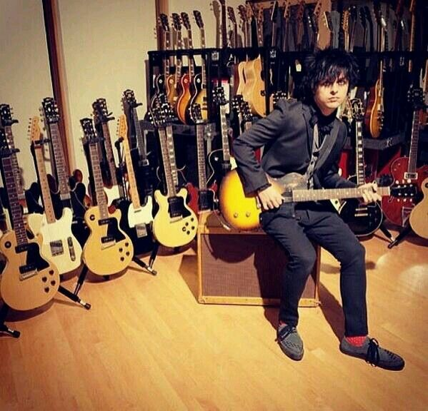 Imagine having that many guitars.. imagine having BILLIE<< He looks scared, like he thinks the person taking that picture is having that same thought