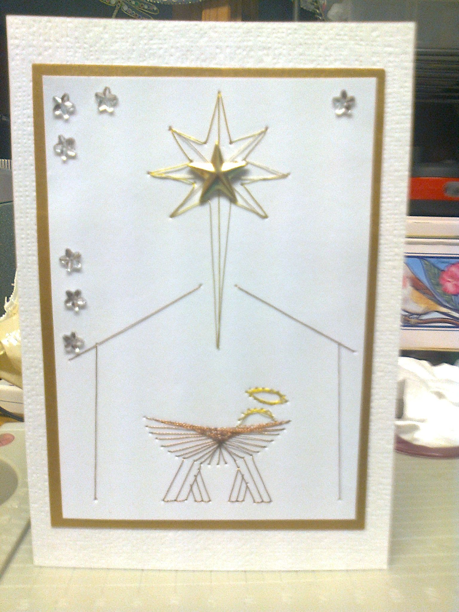hand made Christmas card with sewn image from form a lines