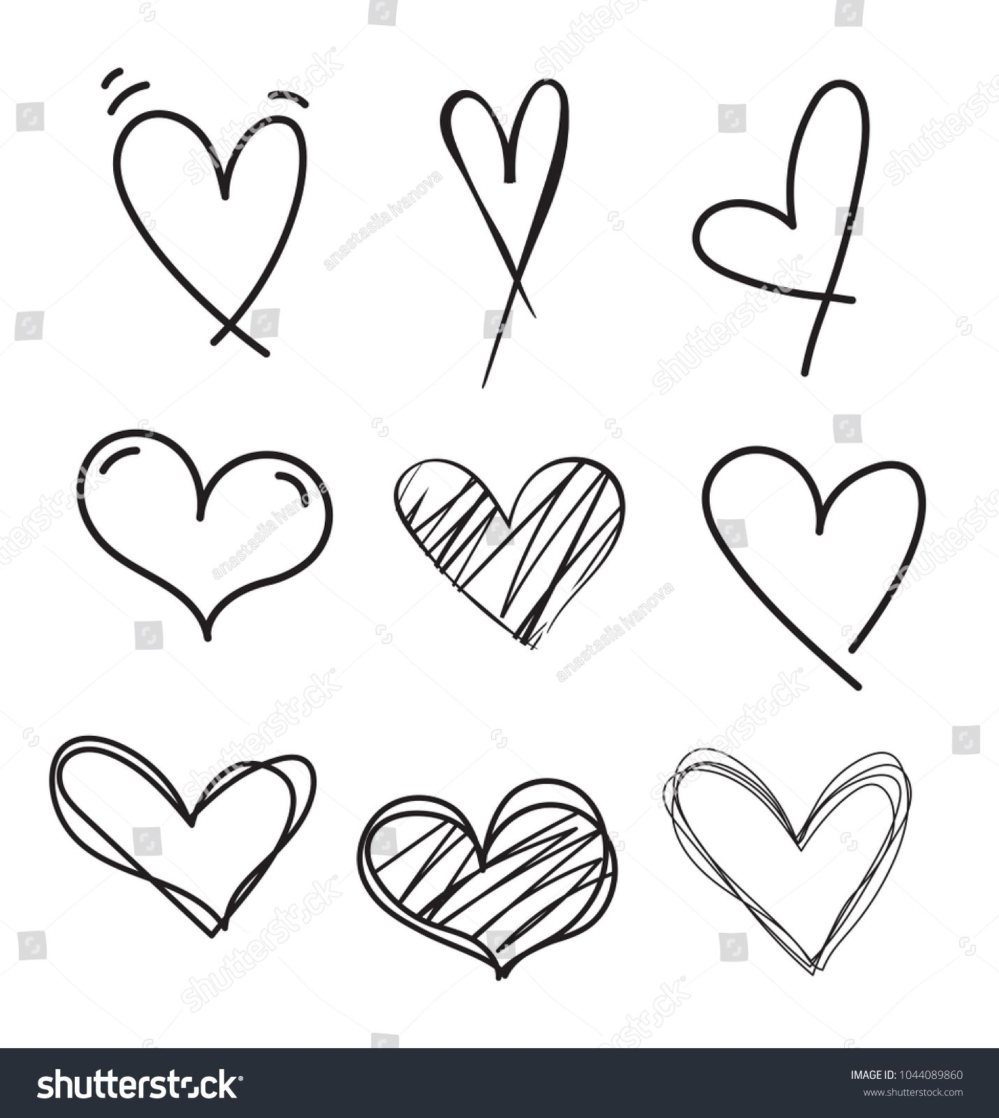 Set of outline hand drawn heart icon.Hand drawn doodle