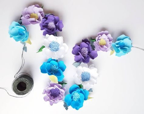 A new felt flower garland will be listen soon in my Etsy shop.  Floral fiesta of turquoise lavender and white