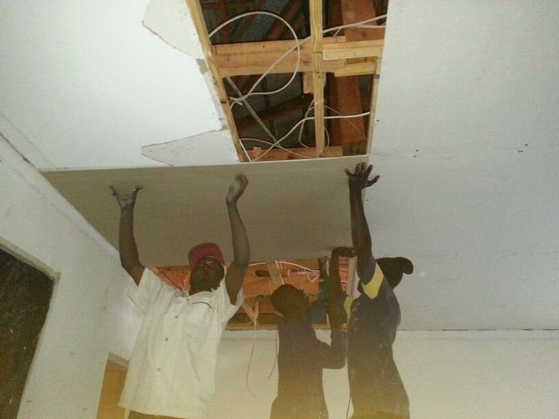 Ceiling boards being fitted