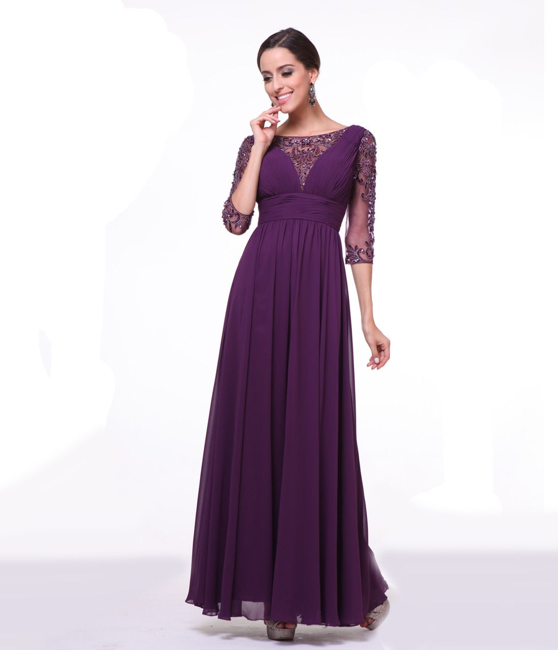 Deep eggplant dress. Three quarter length sleeves and an empire waist. The bodice and sleeves are complete with embellishments and a long flowing chiffon skirt completes the look!