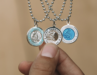 Sterling Silver Saint Christopher medal for a child.Decorated on front and reverse With presentation case.