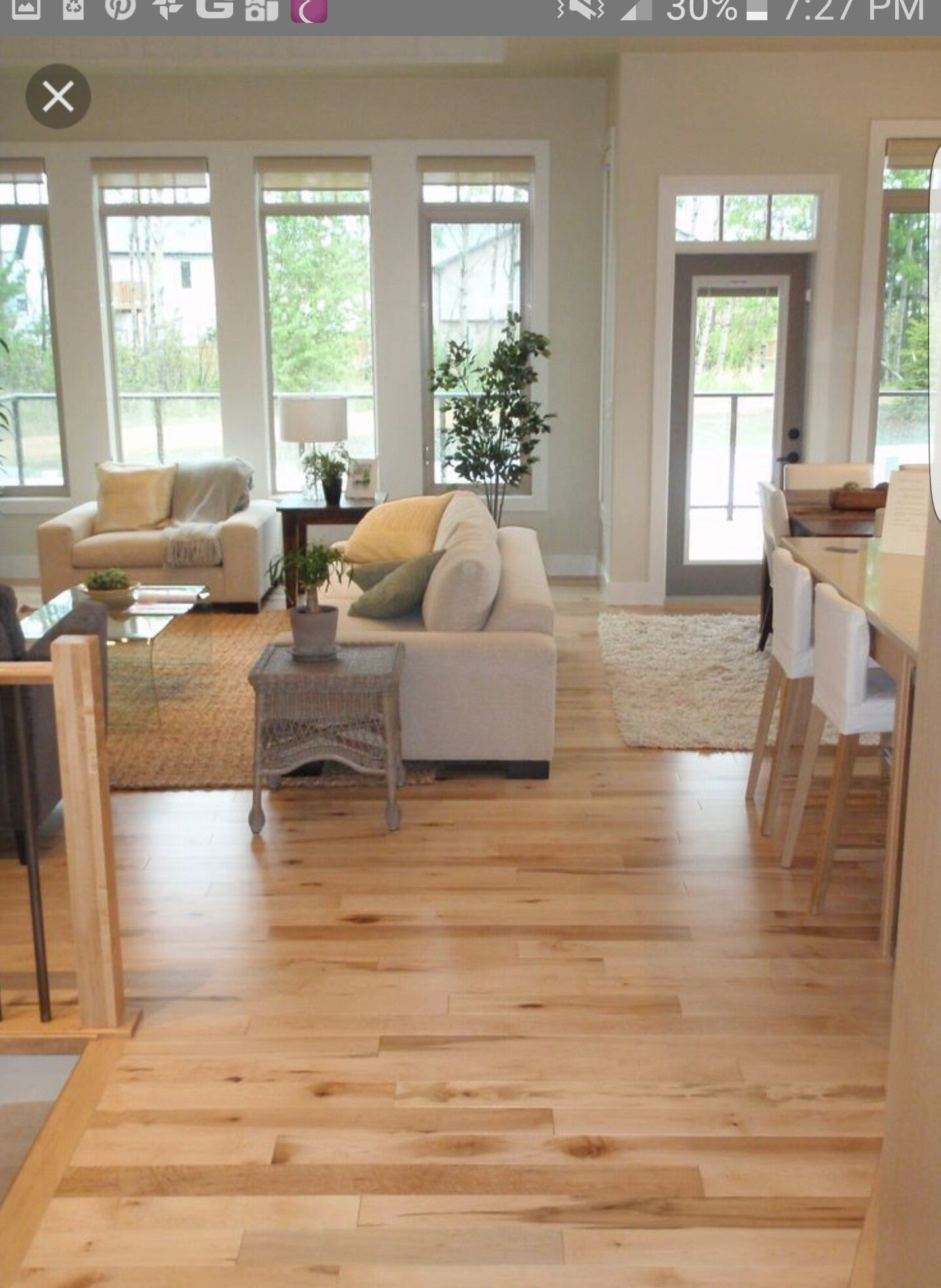 maple flooring with very offwhite walls (pinkish? and