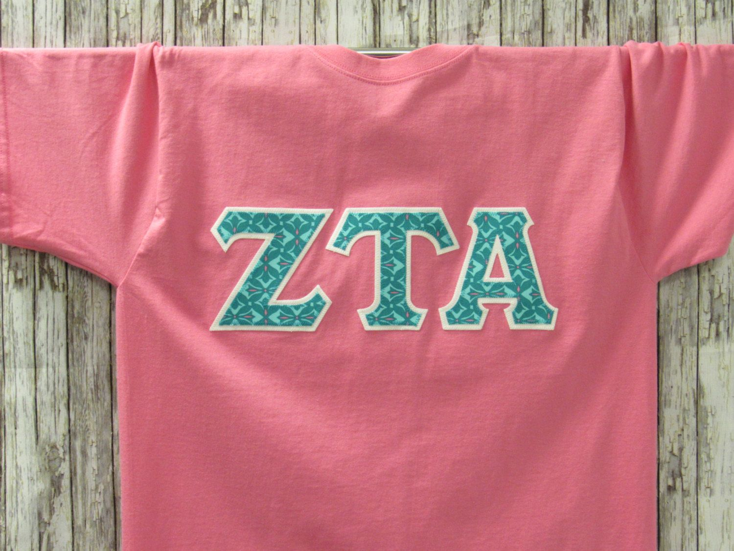 pink short sleeve with turquoise blue print letters sorority double stitched letters shirt