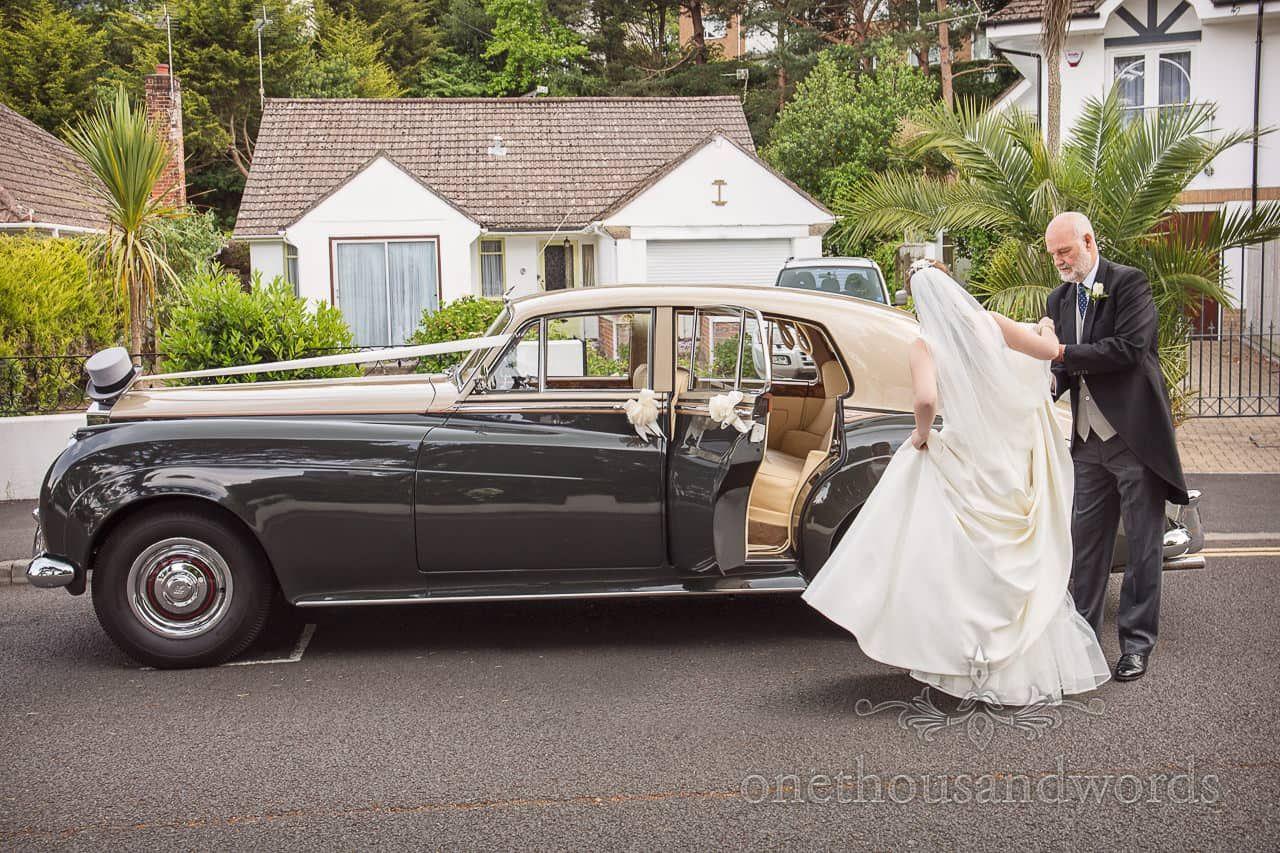 Bride entering classic Rolls Royce wedding car # ...