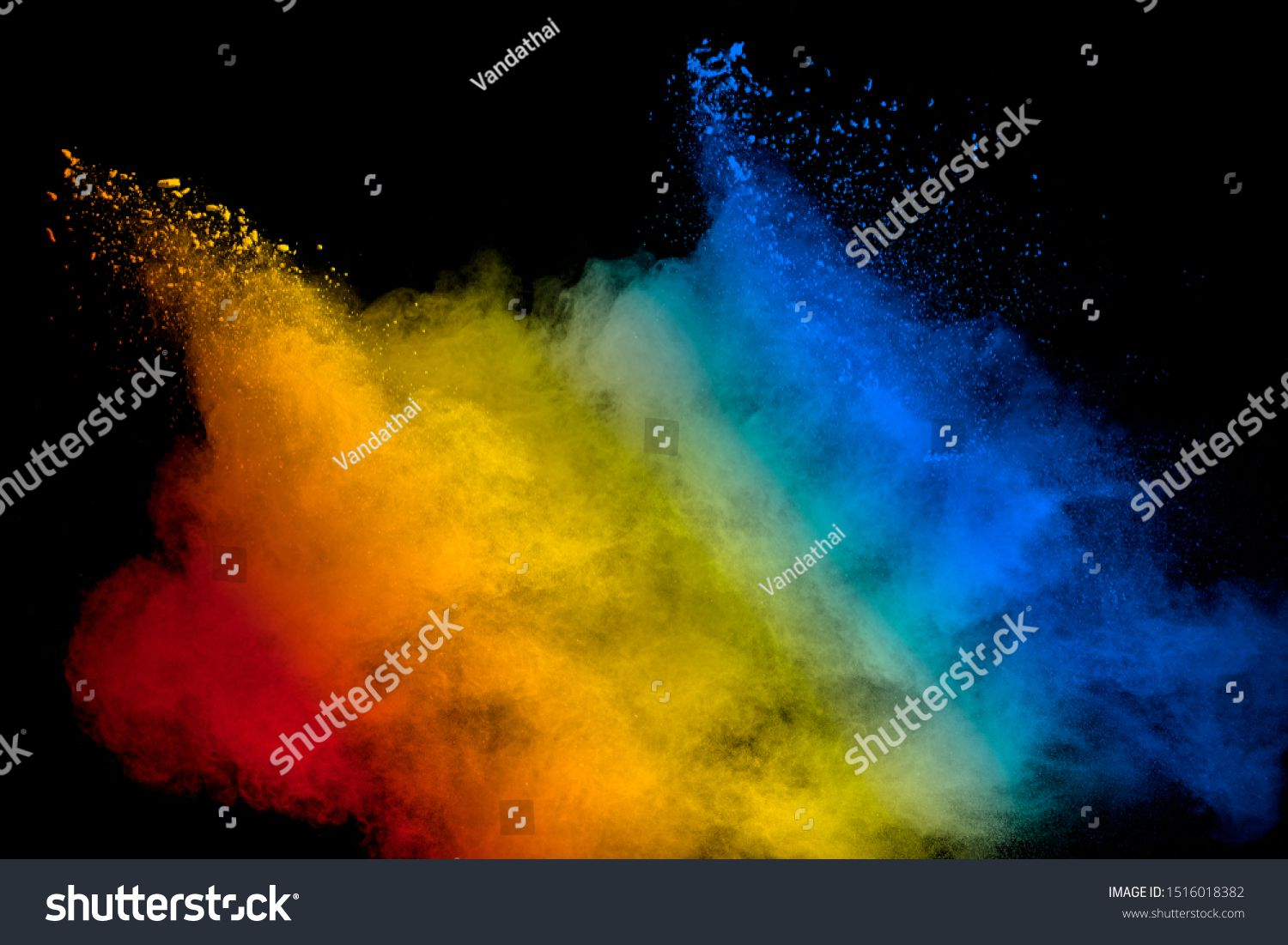 Abstract Multicolored Powder Explosion On Black Background Red