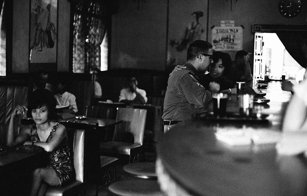 GI and bar girls in a bar during the Vietnam War in ...