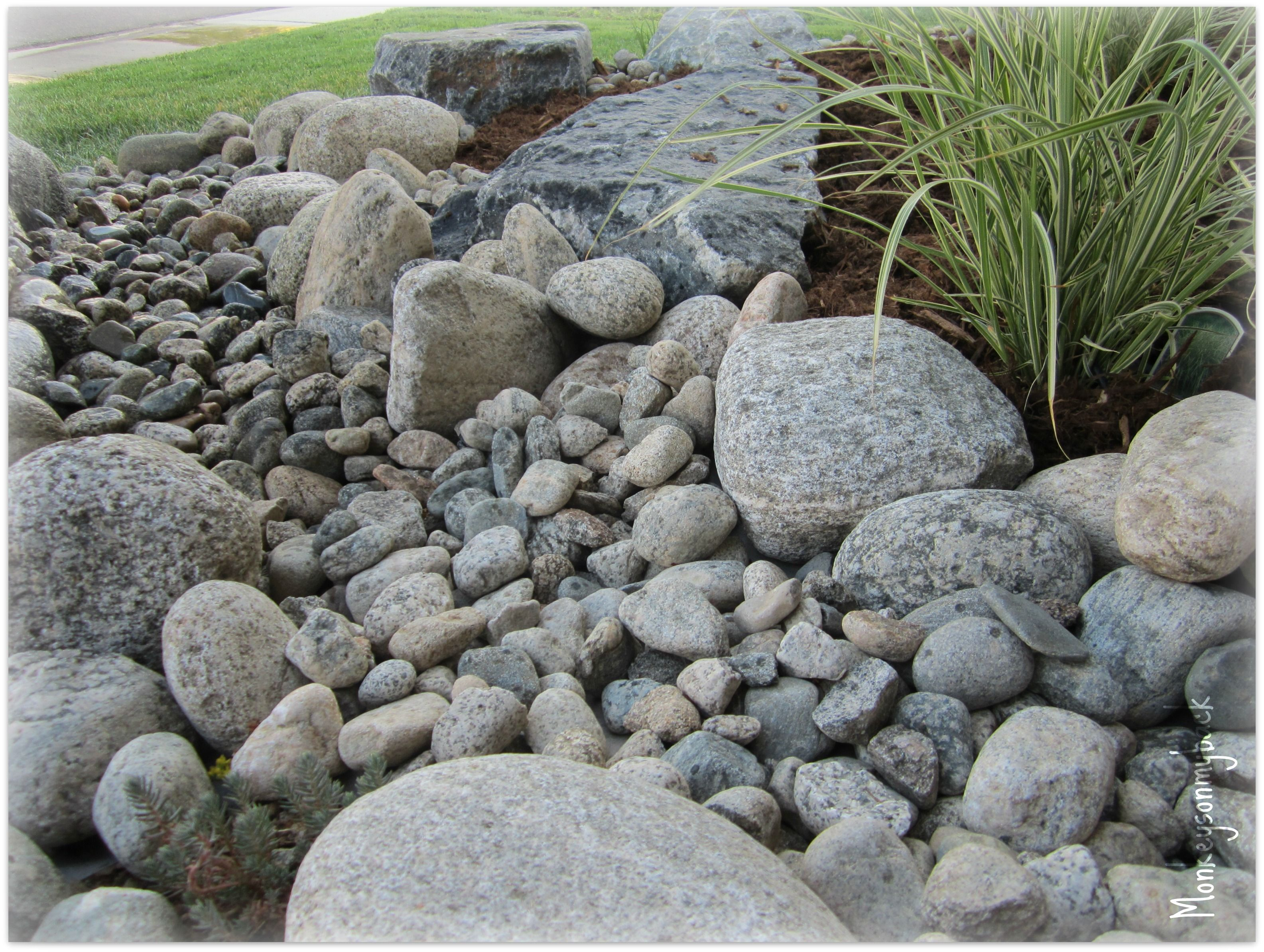 River rock garden river rock raised garden beds for River rock landscaping ideas pictures