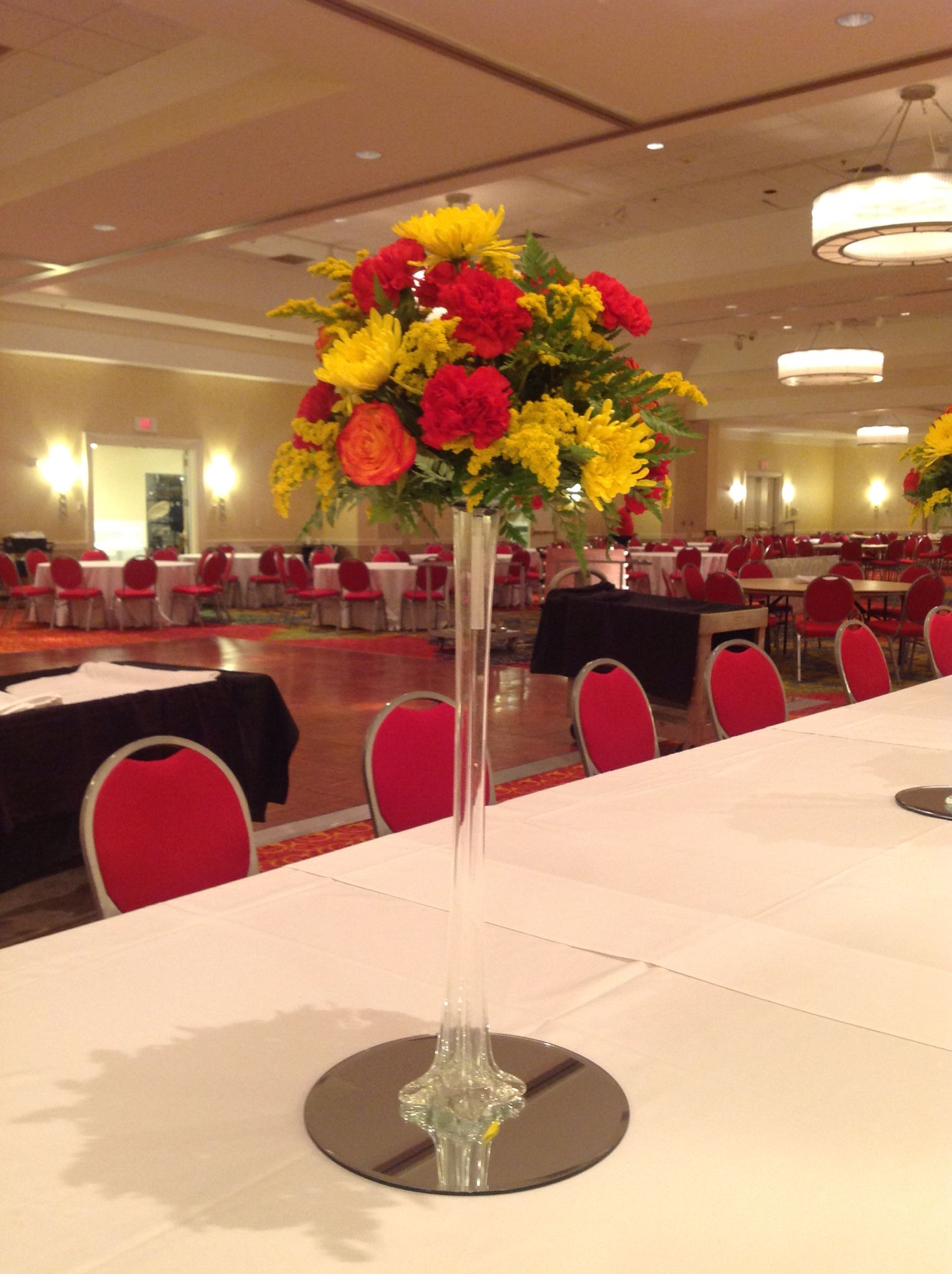 A Beautiful Orange Yellow And Red Centerpiece Centerpiece Red Orange Yellow Red Centerpieces Centerpieces Table Decorations