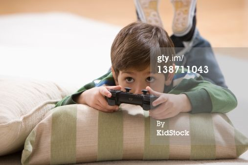 Stock Photo : Caucasian boy playing video game