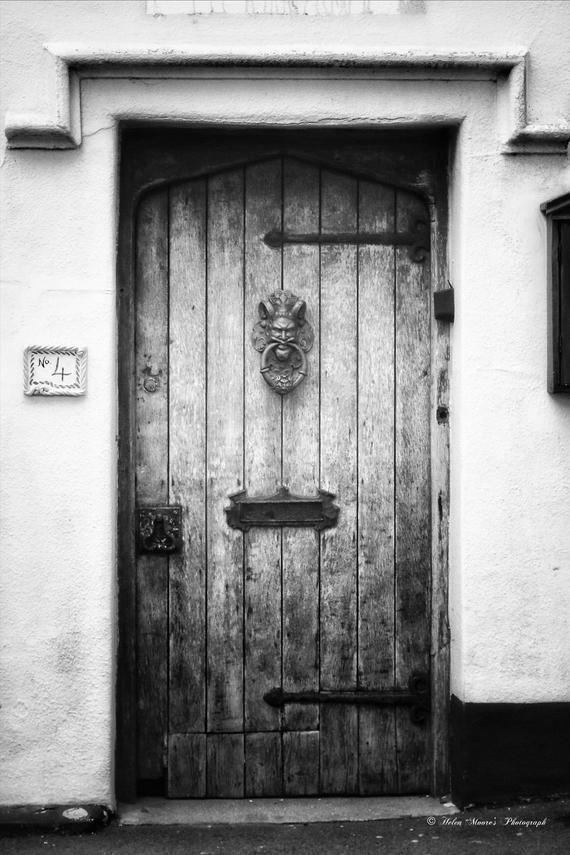 Lion Door Knocker – old wooden door
