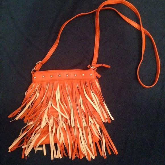 Fringe crossbody purse Long strap, orange cross body. Fringe and stud detailing. Light use, Great condition BONGO Bags Crossbody Bags
