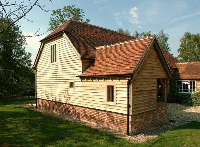 Oak framed garages exposed brick contrast with for Weatherboard garage designs