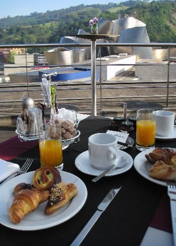 view from the breakfast room terrace balcony at the gran hotel domine in bilbao spain