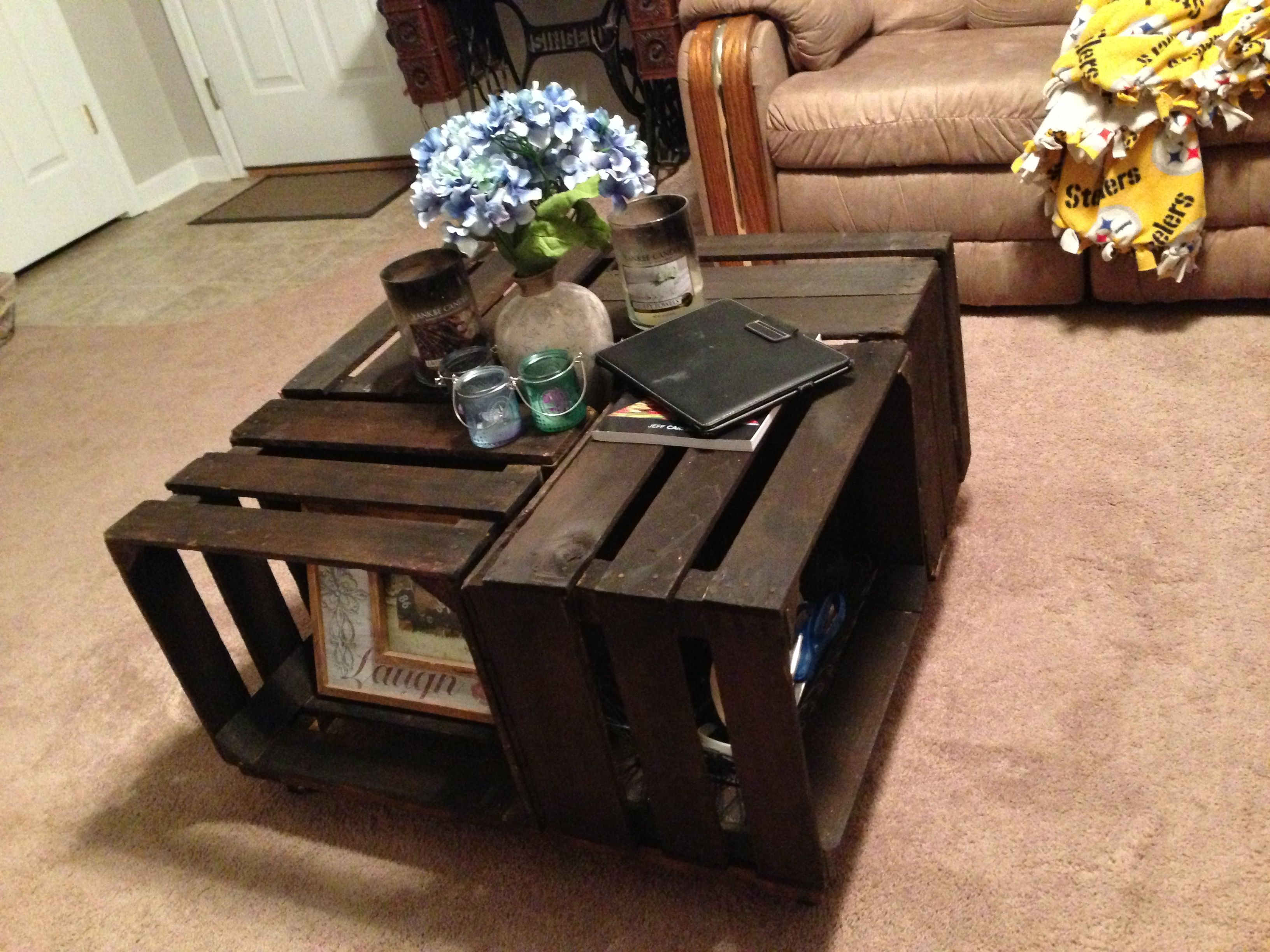 Upcycled coffee table from old wooden crates for the for Coffee table from wooden crates