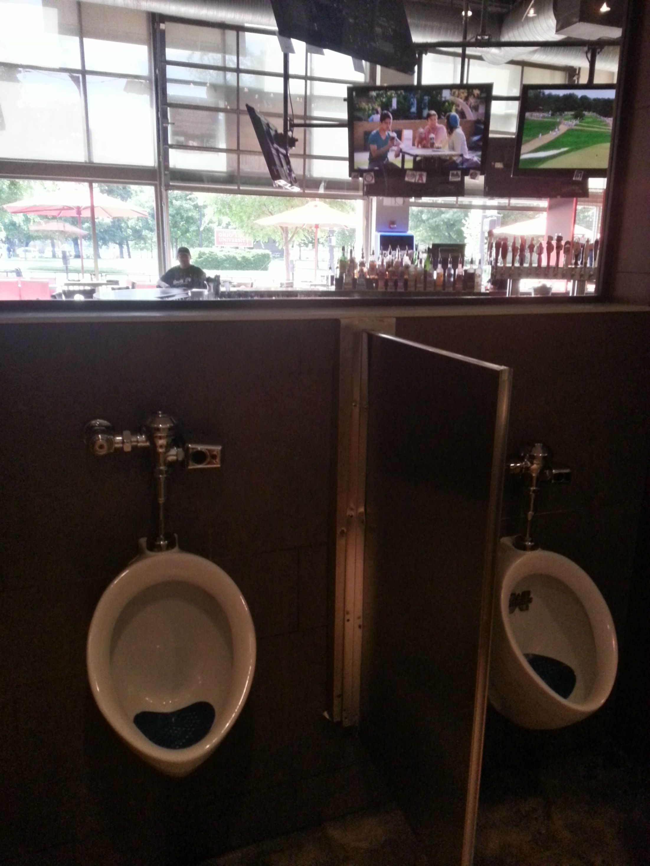 This Sports Bar Has One Way Glass In The Bathrooms So You