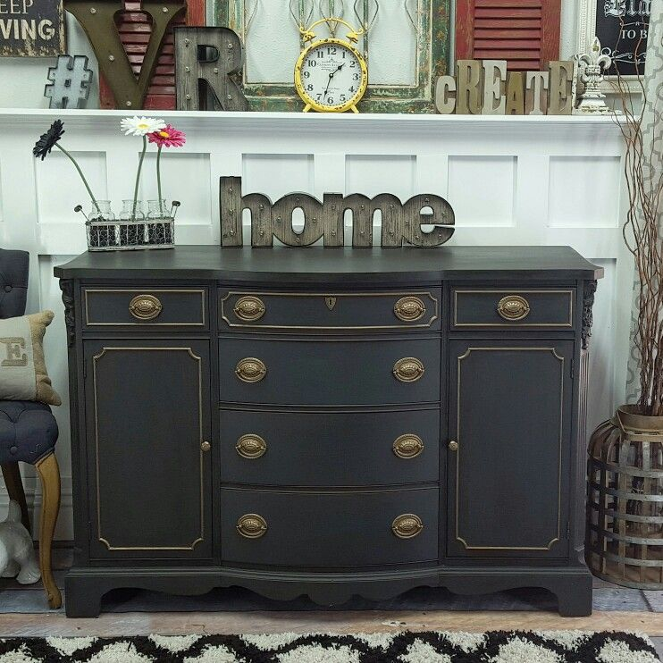 Timeless buffer painted in black with Brass details.