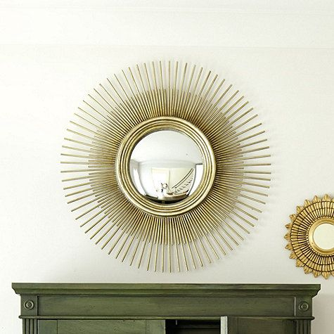 Our Solaine Sunburst Mirror creates a stunning focal point over a mantel, above a console or centered in a grouping of art.