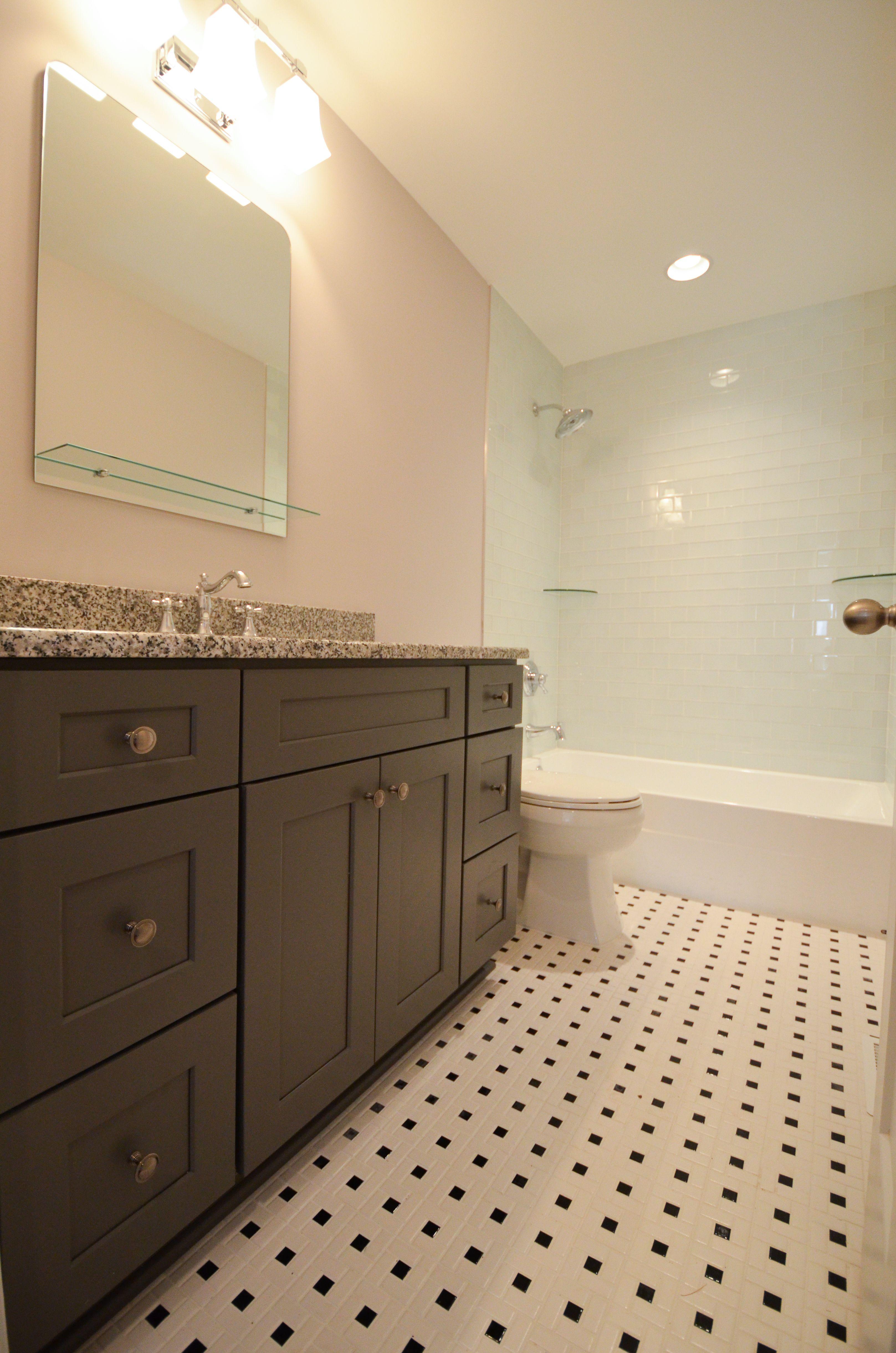 Oversized tub shower combo - with light blue tile, shower shelves ...