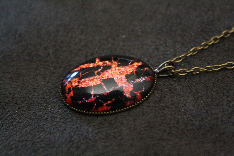 Black Shatter & Icing Tiger's Blood Nail Polish Necklace - Red Orange Glitter. $10.00, via Etsy.