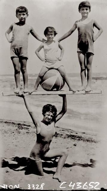 Woman holding up children on the beach 1931 http://t.co/fuibjP3sGO http://t.co/7PeFat1pCl http://t.co/v8M372zvUc