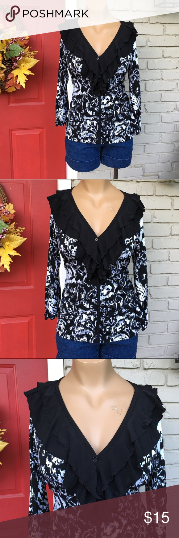 Black white stretch ruffle neck button up top Sexy but sweet black white ikat (?) print button up with large ruffle neckline. Stretchy. 3/4 sleeve. J.T.B. Tops