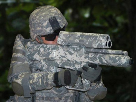 Smart gun fires radio-controlled rounds | The US Army has just unveiled its first smart weapon using smart rounds in small weapons - a gun that can fire rounds that explode exactly at a pre-set distance. Buying advice from the leading technology site