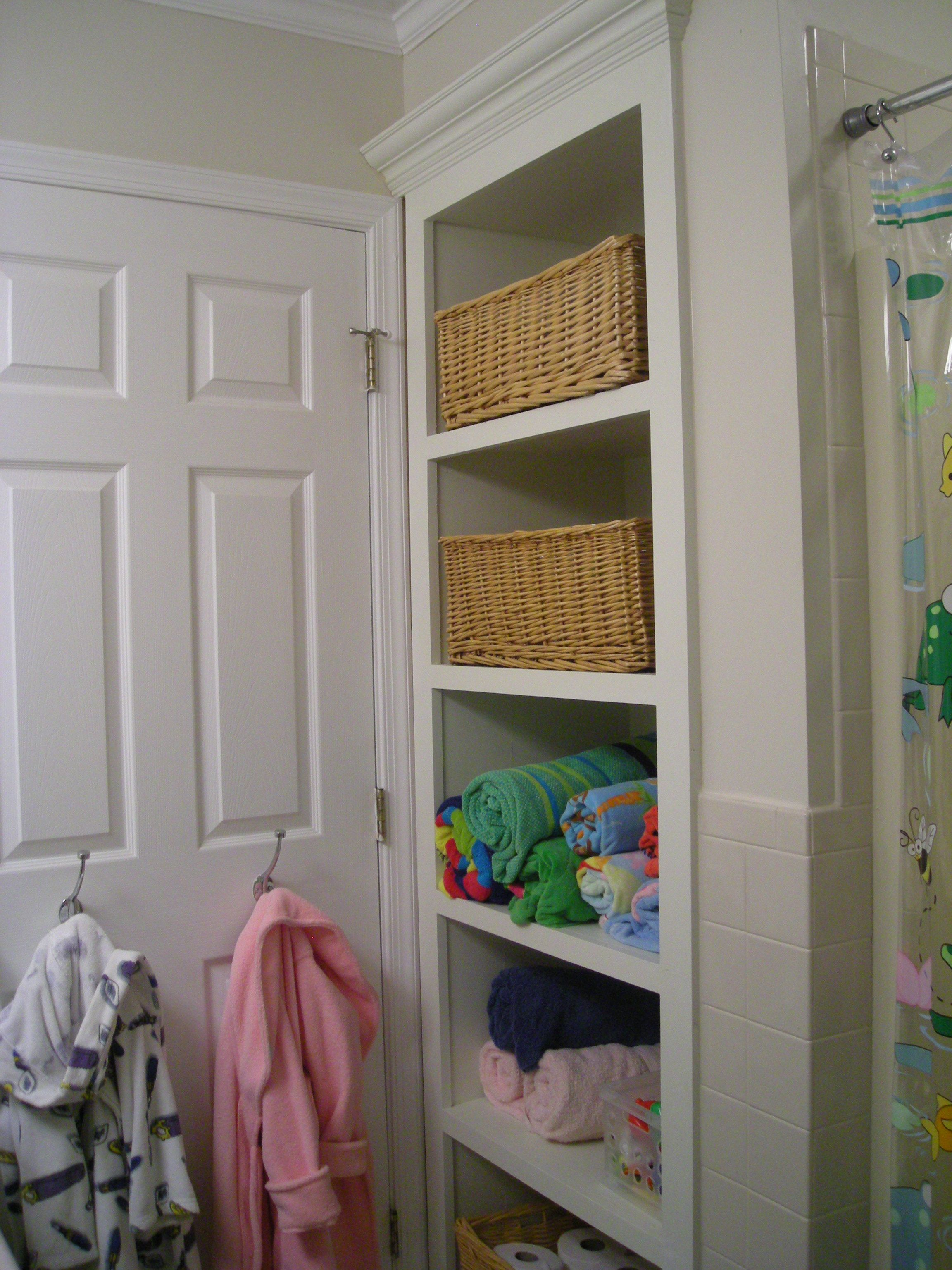 Remodel Bathroom Linen Closet kid's bathroom. replaced the linen closet with open shelving for