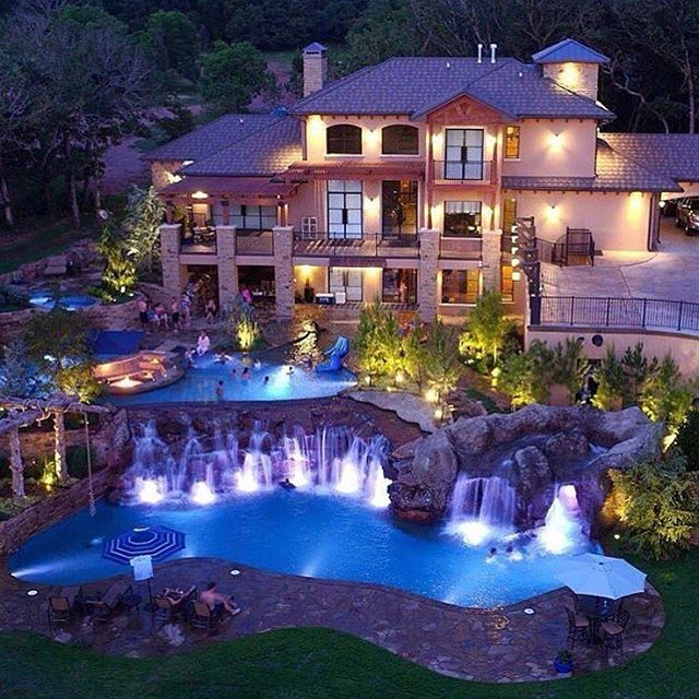grand pools and waterfalls befitting of this magnificent mansion - Big Mansions With Pools