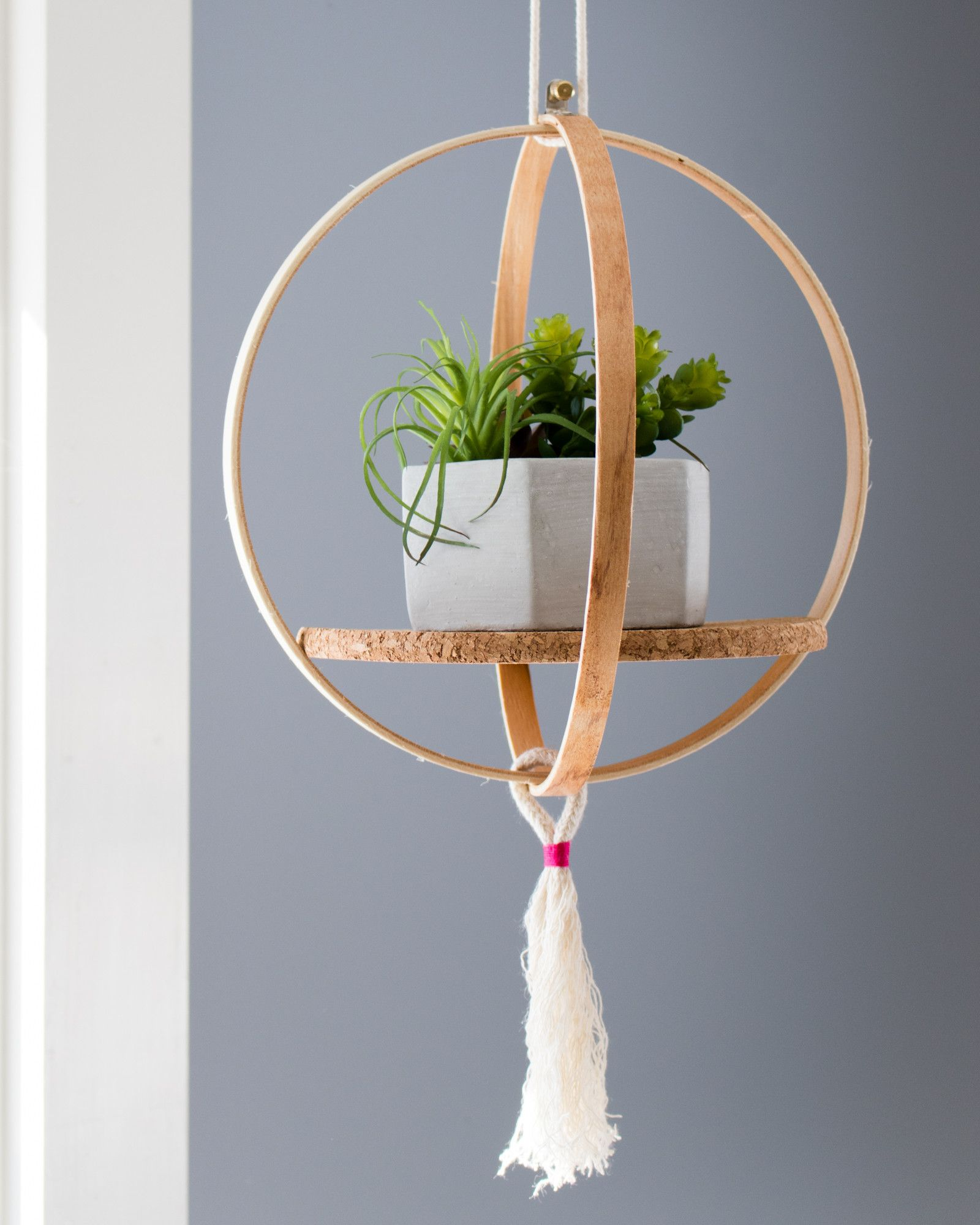 11 Clever Ways To Use An Embroidery Hoop Diy Hanging Planter Diy Hanging Shelves Hanging Plants