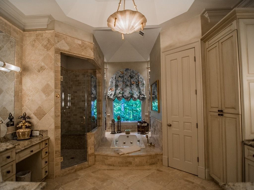 Traditional Master Bathroom with High ceiling, Flush, Crown molding, limestone tile floors, Simple Granite, Jetted