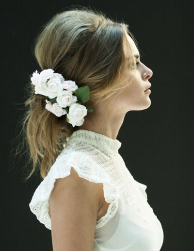 Beautiful hairdo and floral piece