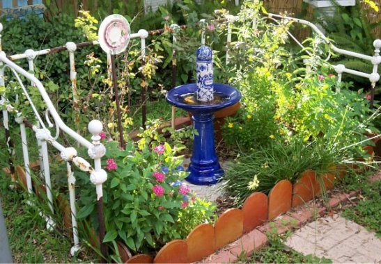 A Decorative Old Bed Frame Fences In A 'whimsie Garden