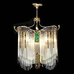 An Art Nouveau ormolu five light chandelier  in the manner of Hector  Guimard of elaborate organic form hung with ten coloured glass panels and  brass and  Art Nouveau columns   Back Decorative Items   Art Nouveau   Art  . Art Deco Lighting Fixtures Chandeliers. Home Design Ideas