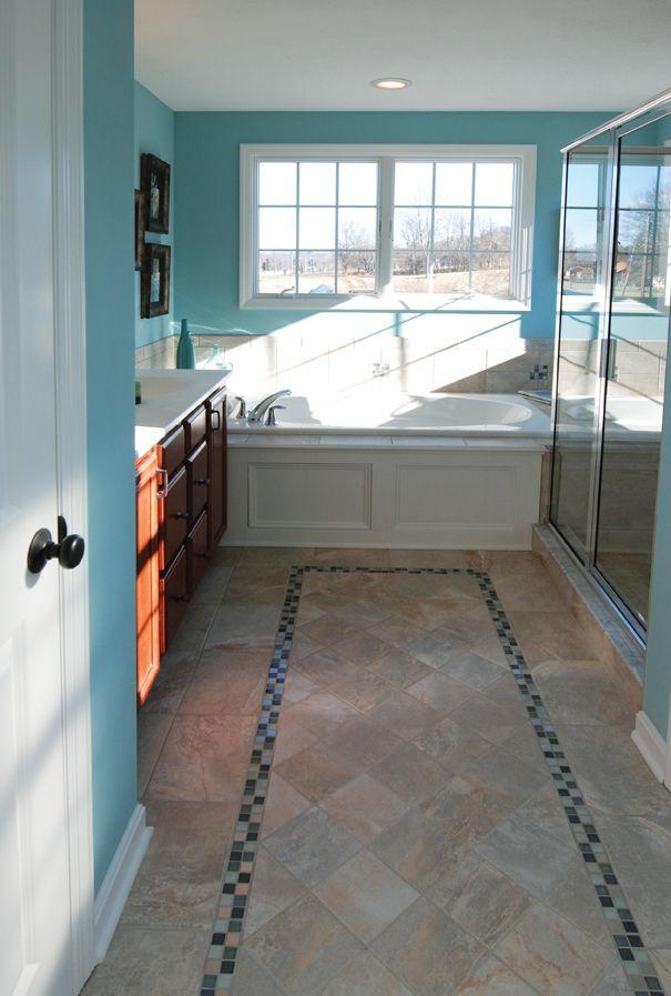 love this bathroom floor  the color  unique tile tile