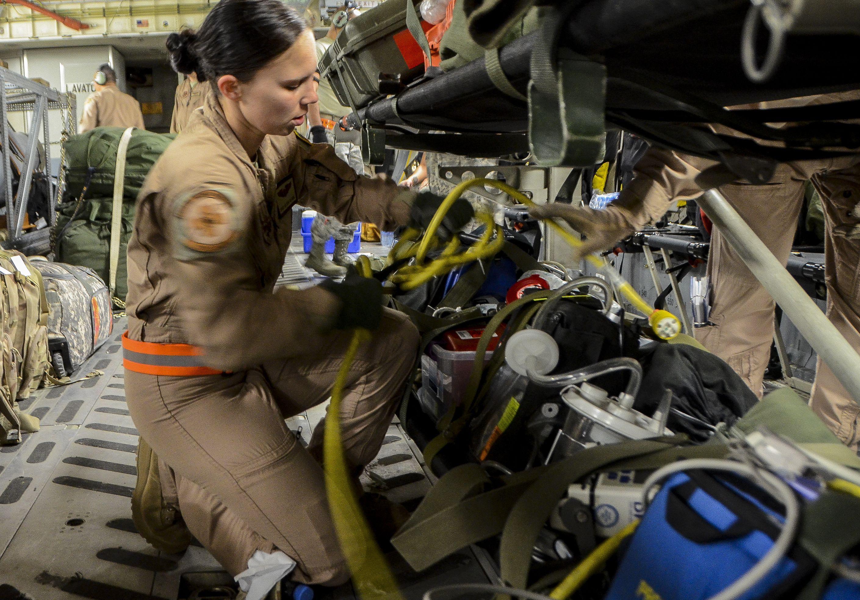 Staff Sgt. Alicia Clark readies medical equipment before