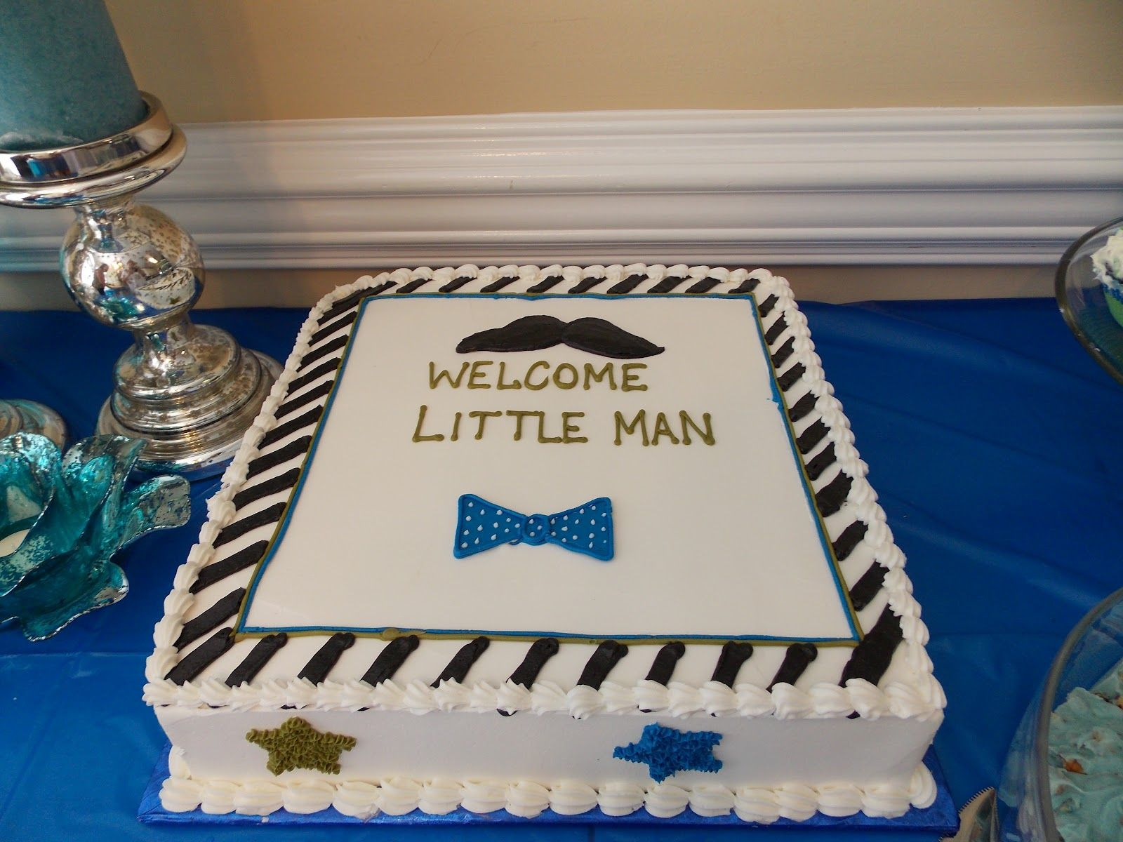 "Love this sheet cake for a ""little man"" theme"