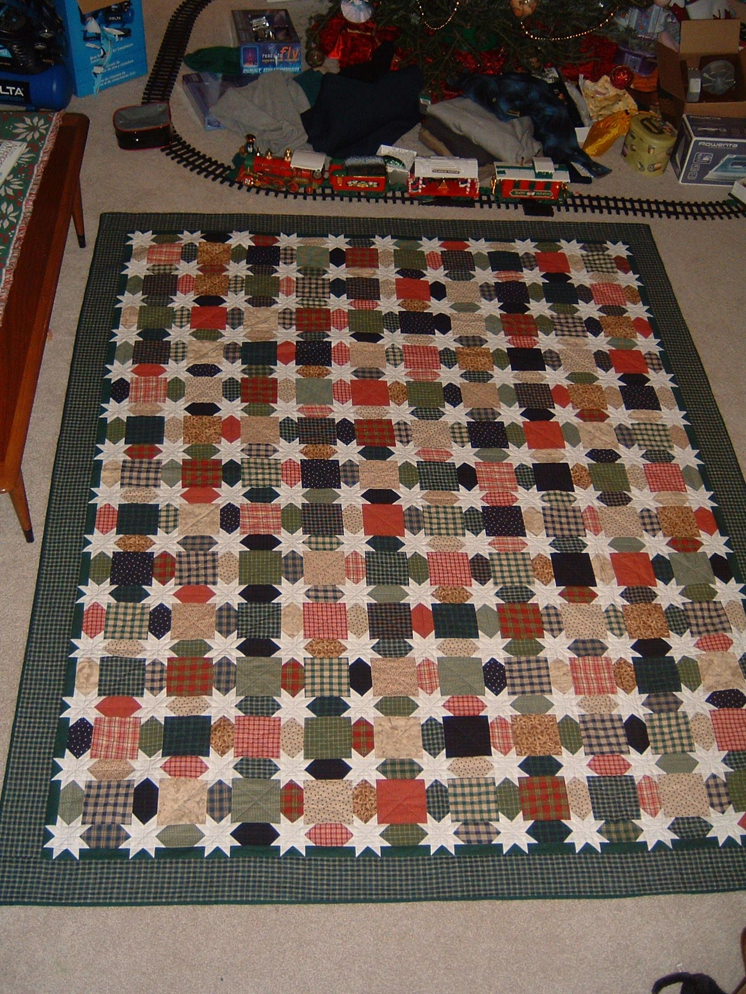 This is a very special quilt I made for my Father for Christmas made of homespun and flannel on the back.