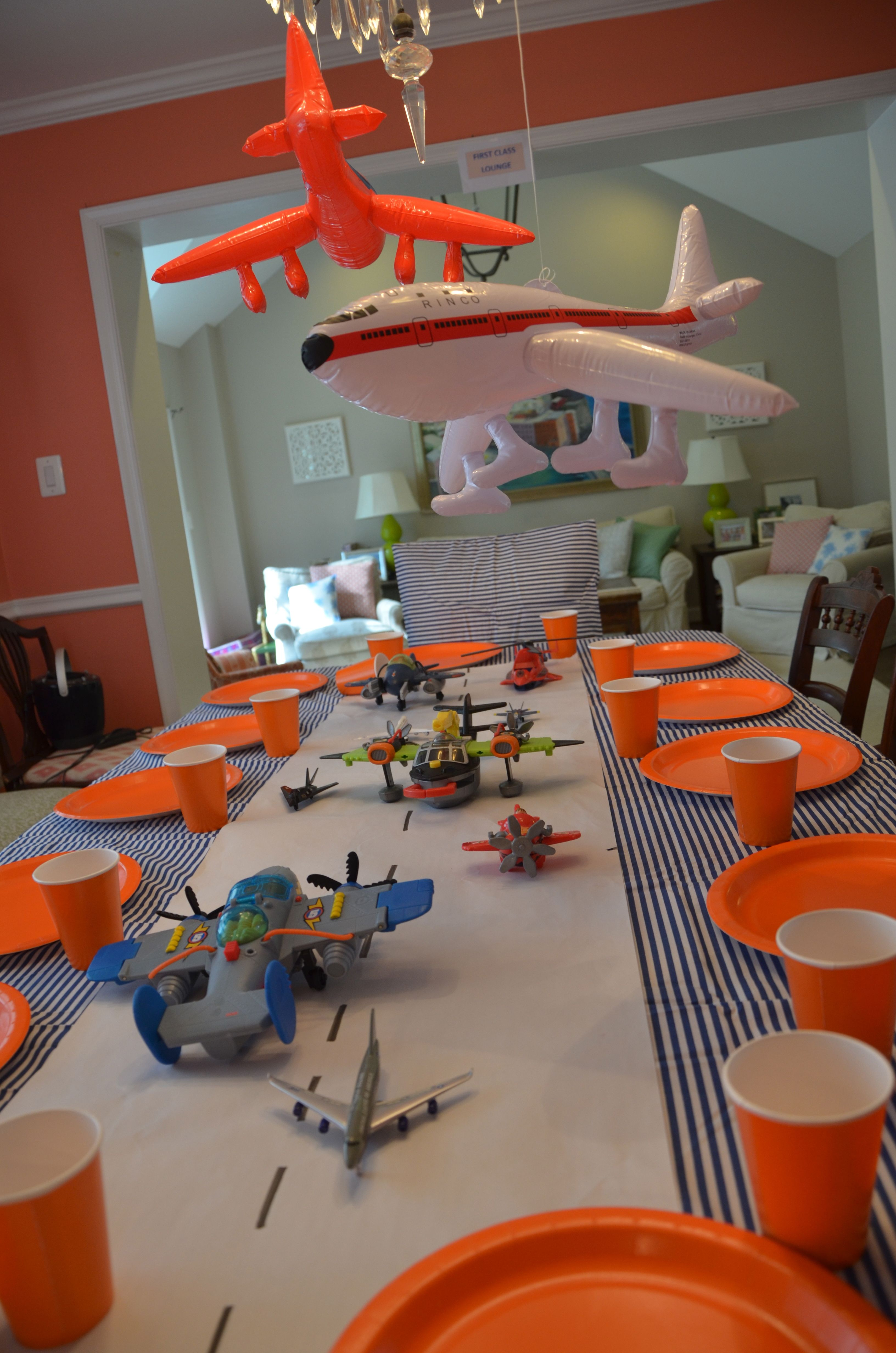 Airplane Birthday Paper runway and toy planes table cloth is a bed