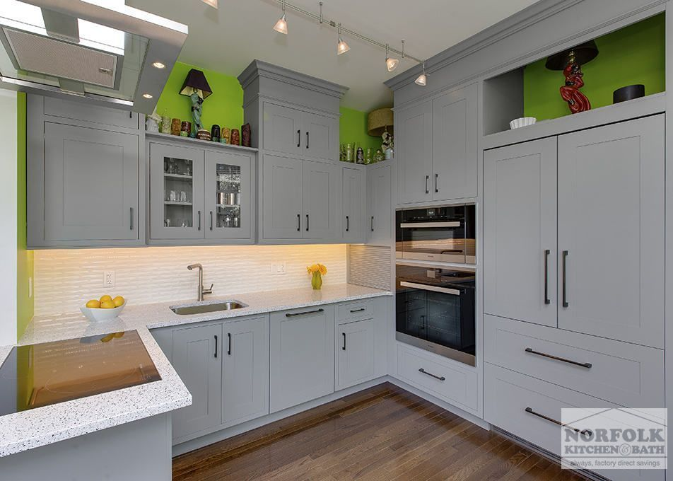This contemporary kitchen by Touchstone Cabinetry features a Shaker